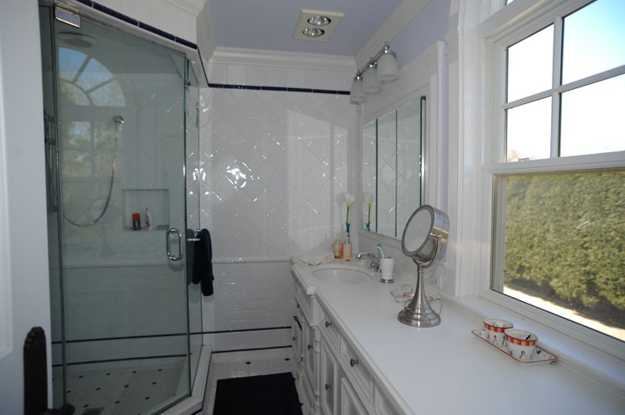 modern bathroom with glass show door and large window
