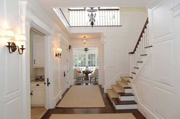 traditional staircase and entryway design