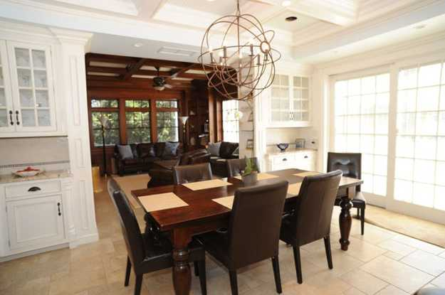 dining room with large wooden table and metal chandelier