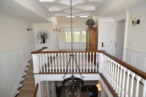 large chandelier and traditional staircase design