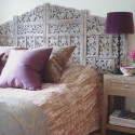 moroccan bedroom decorating with purple color and unique carved wood bed headboard