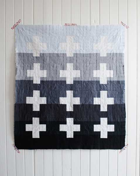 back and white quilt with crosses