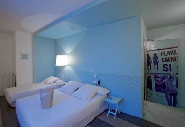 bedroom with blue walls and ceiling