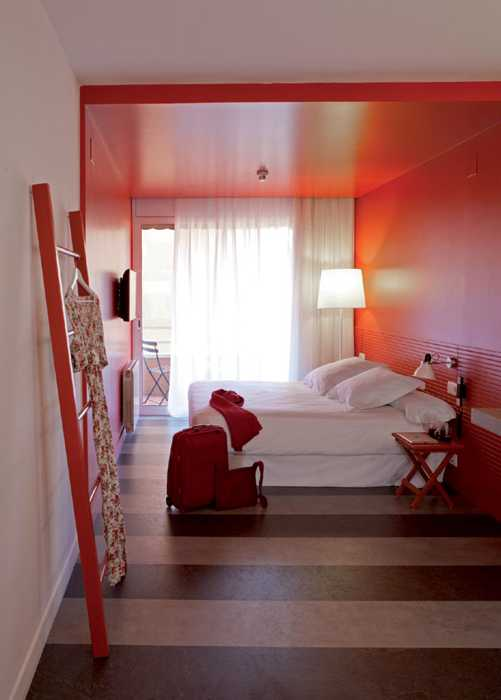 bedroom with red walls and ceiling