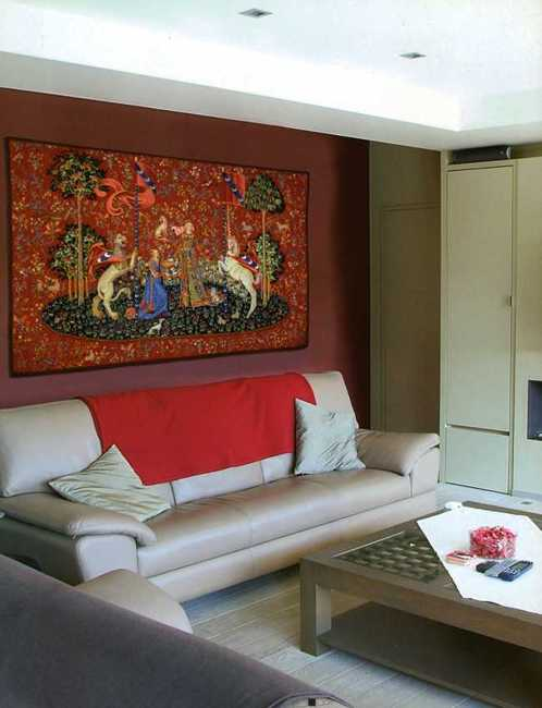 tapestry wall decoration and sofa