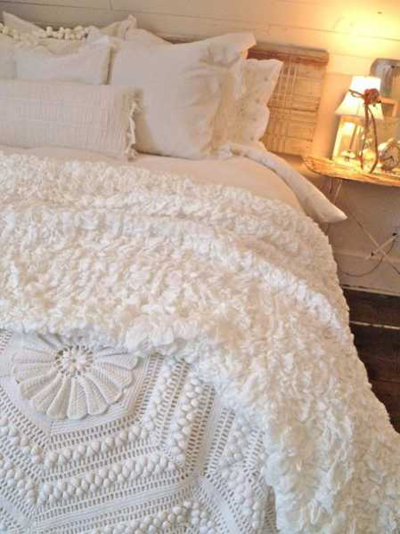 white bedding set with crochet throw