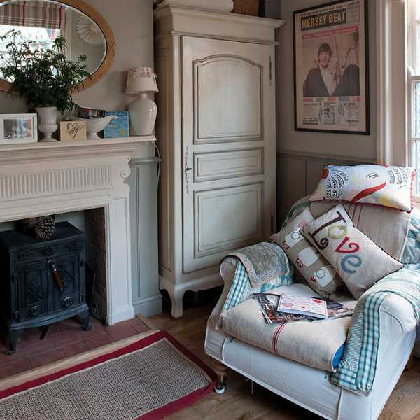 fireplace with chair and vintage furniture for storage