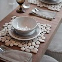created placemats with white pebbles