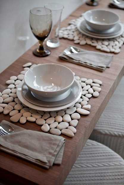 table placemats created with white pebbles