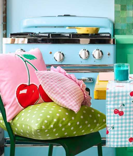 large pillows in pink and green colors