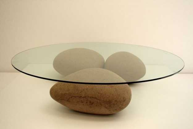 glass top coffee table with base made of beach rocks