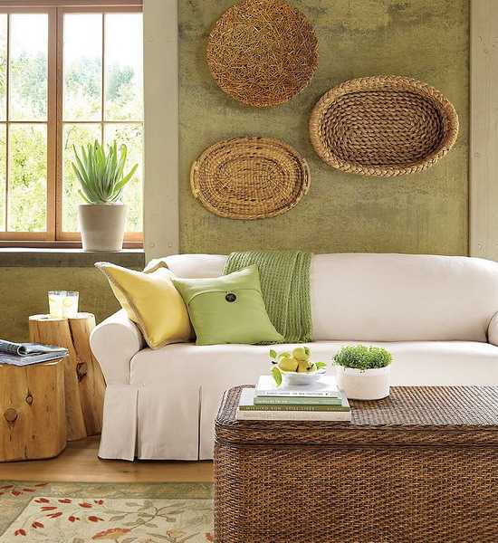 green wall decorating with wicker baskets