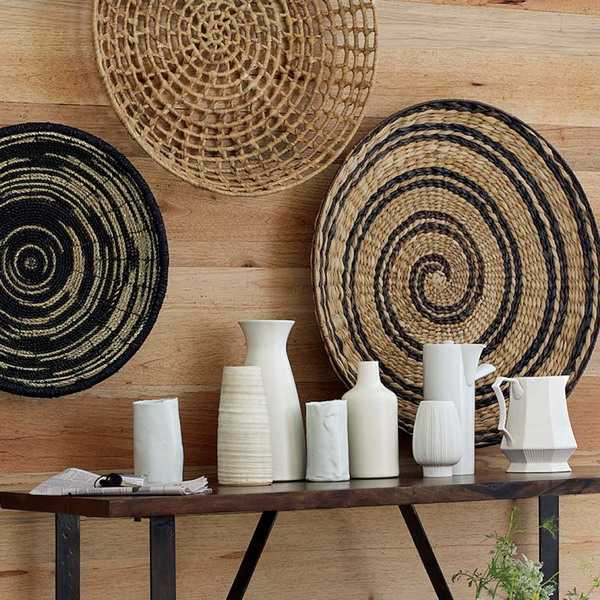 Modern wall decoration with ethnic wicker plates bowls for Art as decoration