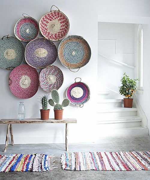white wall decorating with colorful wicker bowls