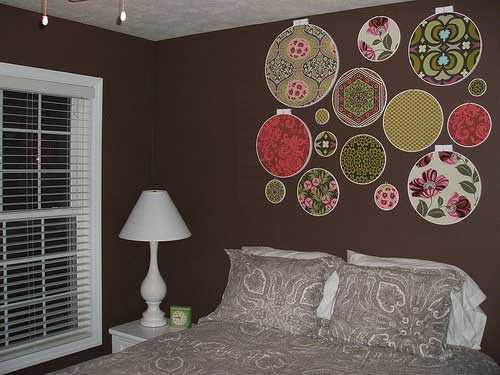 colorful embroidery rings on dark brown wall