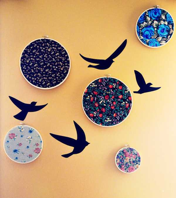 wall decoration with wooden embroidery rings and bird images