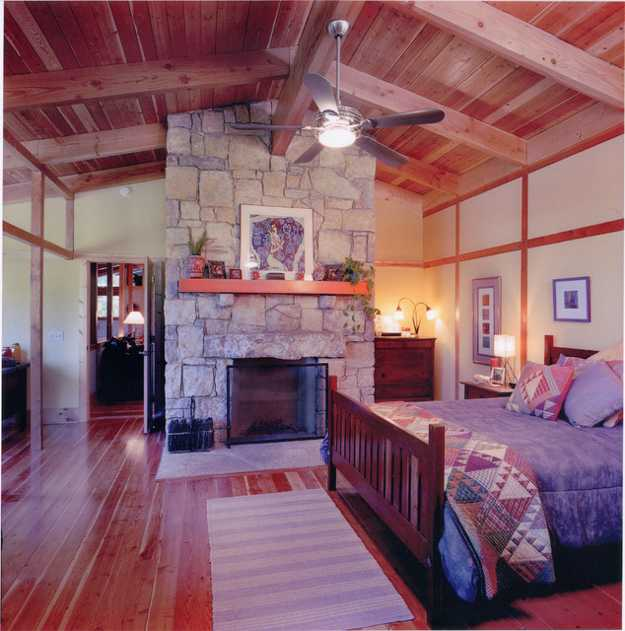 Country home style bedroom with a fireplace, bedroom decorating ideas