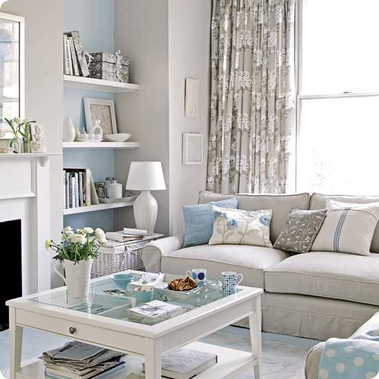 white living room furniture with decorative pillows