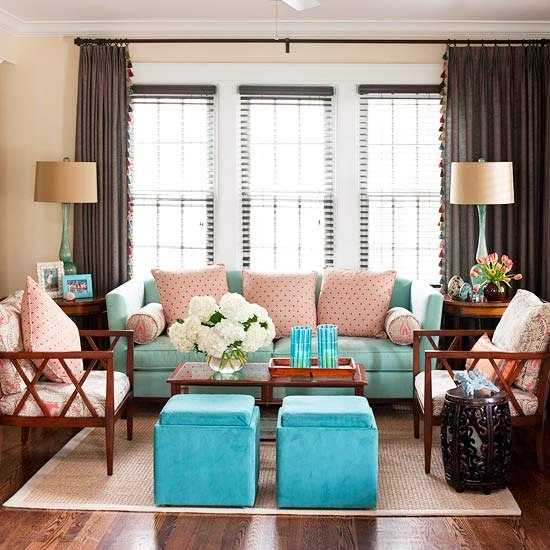 blue living room furniture and pink decorative pillows