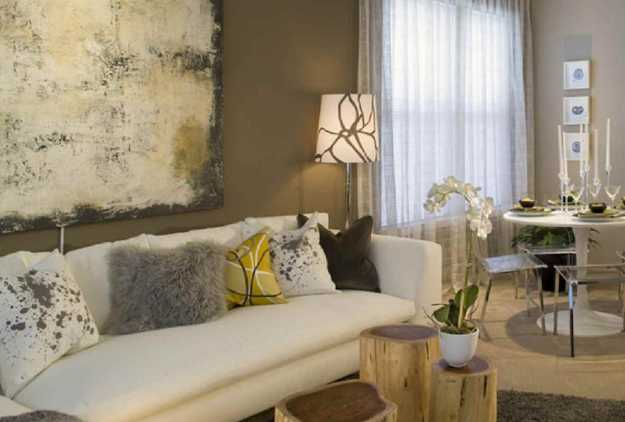 white living room sofa with pillows made of different fabrics
