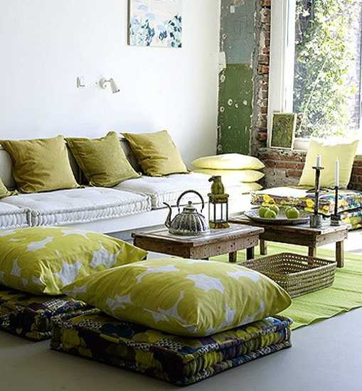 small and large pillows in green color for living room decorating