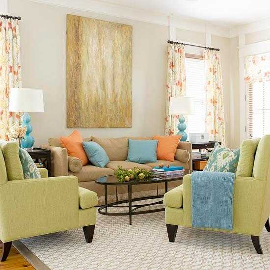 green living room furniture with blue and orange decorative pillows