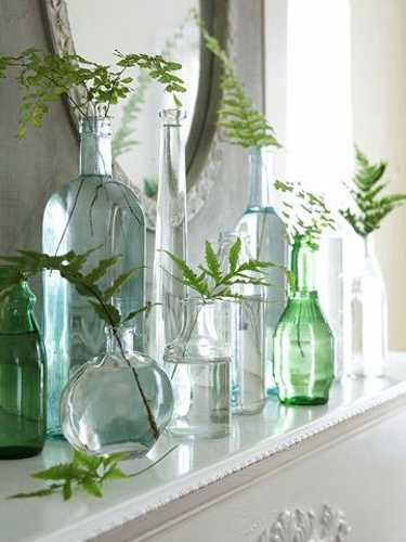 vintage table centerpieces, glass jars and green leaves