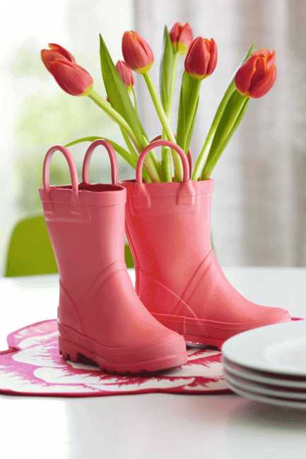 rain boots and flower arrangement for spring table decoration