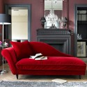 red Recamier for living room decorating with fireplace, large wall mirrors and crystal chandeliers