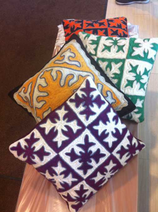 colorful felt pillows with appliques