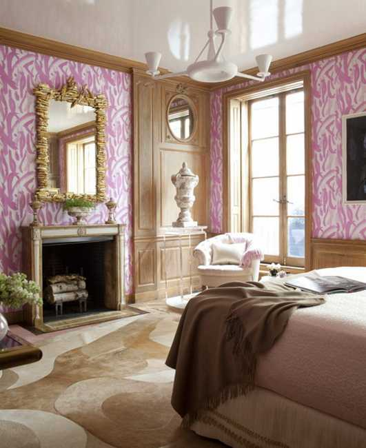 bedroom design with fireplace and pink walls