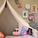 girls bed with fabric canopy