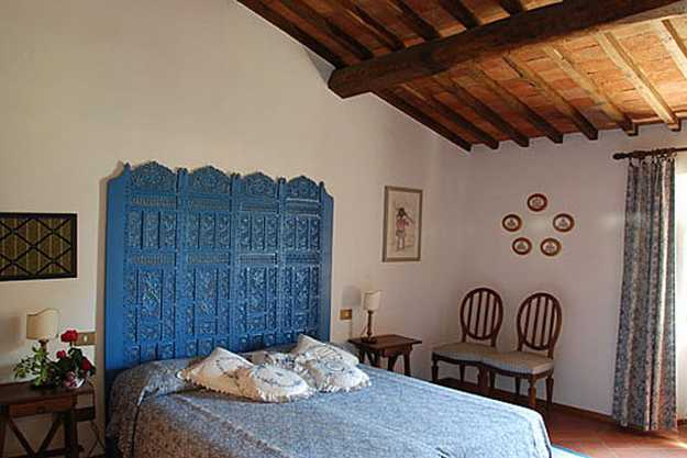 carved wood bed headboard and wooden ceiling