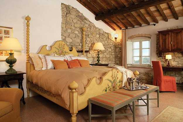 wood ceiling and stone wall design in bedroom