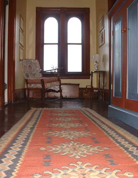 ethnic interior decorating with kilim, hallway floor rug