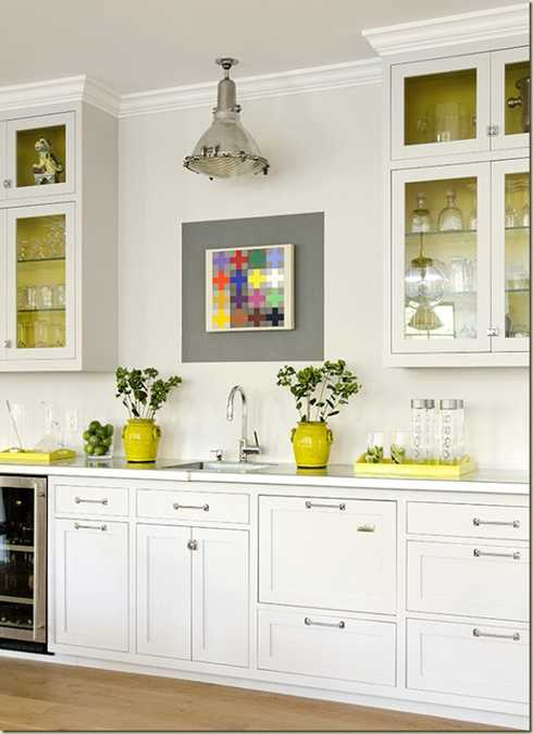 Yellow color accents jazz up elegant dark gray kitchen for White kitchen wall decor