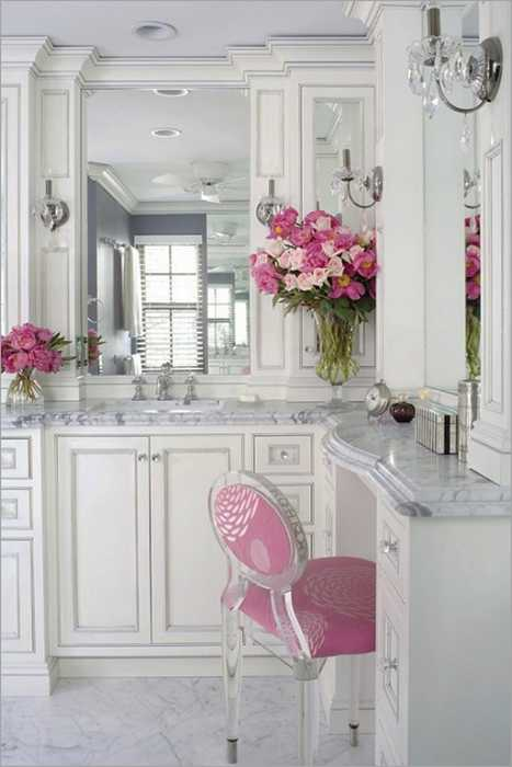 White bathroom decorating with pink flowers and chair