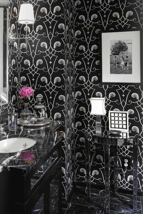 black and white bathroom design with clear plastic table and pink flower arrangement