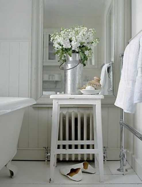 white bathroom decorating with flowers