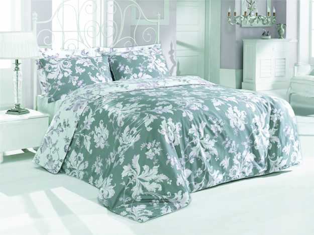 pastel green and white bedding set with floral design