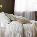 bedding set in light neutral colors