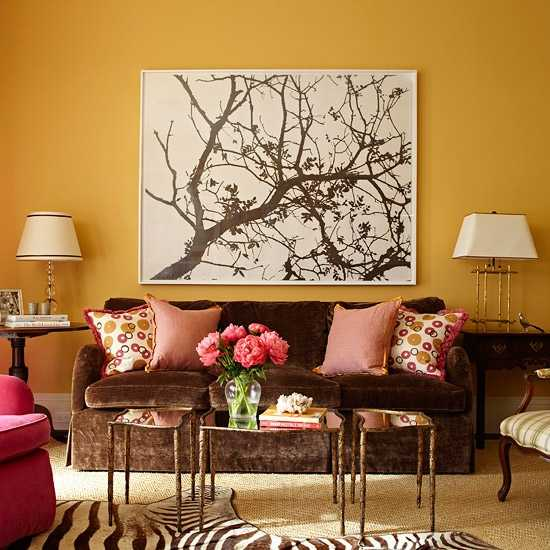 living room with tree painting on wall