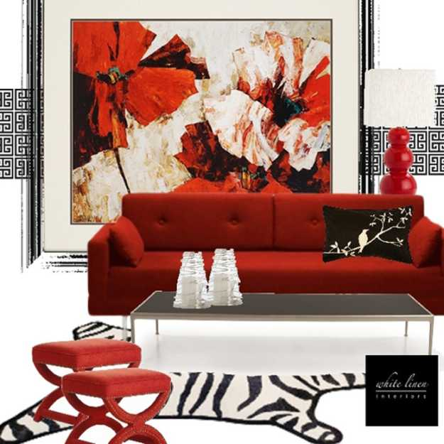 red accent wall design with floral wallpaper and red living room furniture