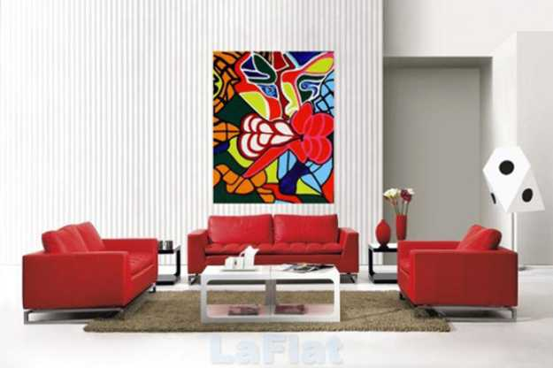 red living room furniture and bold wall art