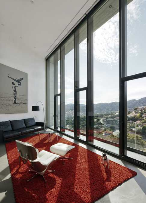 red floor carpet in black and white living room with large windows