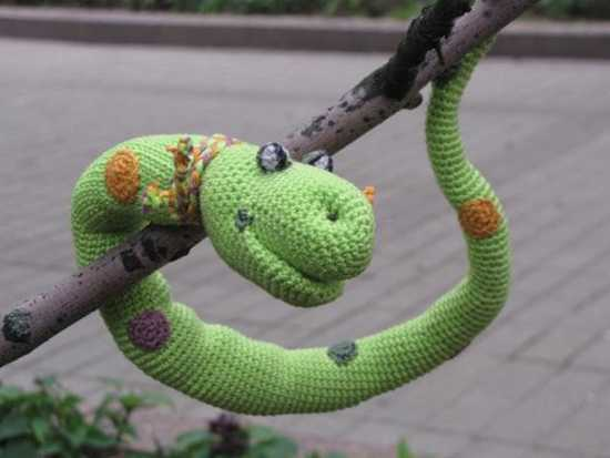 crocheted snake in green color