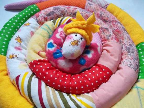 colorful snake toy and large pillow