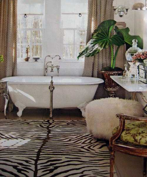 claw foot bathtub and zebra floor rug for black and white bathroom decorating