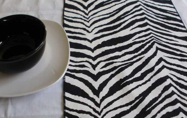 zebra fabric print, table runner and black and white tableware set