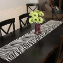 black dining table and black-n-white table runner